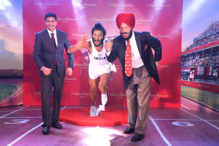 Flying Sikh Milkha Singh along with his wax figure for Madame Tussauds and Mr Anshul Jain, General Manager and Director, Merlin Entertainments India