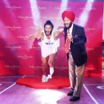 Flying Sikh Milkha Singh posing with his wax figure for Madame Tussauds.