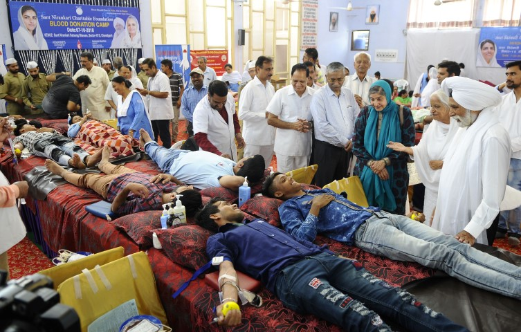 420 devotees including 64 women donate blood