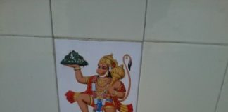 Shop keeper affixed 14 tiles that have pictures of gods