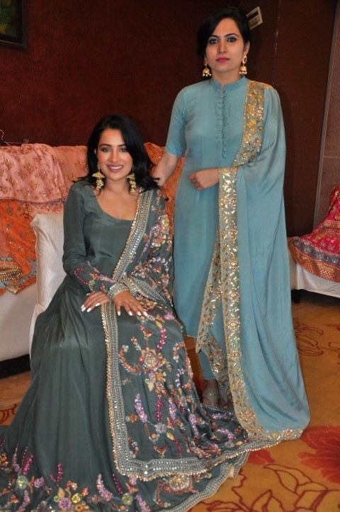 "Fashion designer Nimrat Kahlon's first bridal series unveiled by actress Sara Gurpal · Designer Nimrat Kahlon's first bridal collection unveiled, dresses showcased by actress Sara Gurpal in backdrop of Rajasthan's Rajvi Palace Chandigarh, Aug 12, 2019: After making a mark in creating designer wear for top notch heroines in the Punjabi movie industry, Chandigarh based fashion designer Nimrat Kahlon has come up with her maiden 'Royal Bridal Collection.' The breathtaking ensembles which comprise of seven bridal dresses were unveiled by famous Punjabi film actress and model Sara Gurpal here. Dr Nimrat Kahlon is the designer and owner of Chandigarh's luxury clothing label 'Nimrat Kahlon'. While pursuing her Ph.D on an esoteric topic she gained a thorough knowledge of history of Indian costumes. This further ignited her to venture into fashion designing which offered her a platform to utilise her deep understanding of fashion. The event in which the eclectic and attractive collection was showcased saw Sara Gurpal dressed in one of the bridal dresses. Nimrat also showcased the enchanting videos of her 'Royal Bridal' collection, which features Sara Gurpal. The bridal collection has been exotically filmed against a mighty backdrop of a heritage building – Rajvi palace, Hanumangarh, Rajasthan. Nimrat is the first designer from Punjab who has used backdrops of Rajputana forts of Rajasthan to showcase her dresses. She has also used matching jewellery from Om Jewellers, Patiala, which fit into the theme of the dresses well. Nimrat said, ""The idea is to popularize the rich Punjabi culture and clothes in areas outside Punjab. This way the rich Rajputana traditions and our vibrant Punjabi culture both get promoted."" In the shoot, Sara is depicted in seven different looks of the beautiful collection in which Nimrat has experimented with zesty fresh colors by replacing 'red's' which have dominated the wedding bazaars for years. Unique colors like peach, rose pink, fuchsia, orchid purple, apricot pink, orange and beige have been used while the embroideries are totally contemporary. A delicate handcrafting with pearls, crystals, Swarovski's and beads complement well with the A-line silhouette of the outfits reflecting great precision in their conceptualisation. While addressing the media, Nimrat said, ""This is my first bridal series, which includes 7 different designs and all are lehenga cholis. The designs are unique due to a variety of exclusive materials used and all are traditional but at the same time very much modern and light in weight which makes them easy to carry, for the modern brides. "" In fact the low weight of the dresses is the collection's USP. The bridal lehenga cholis have been crafted with hours of labour, using exclusive embroidery techniques that imparted them a weightless look. Sara said, ""It's a beautiful collection and a great amalgamation of intricate traditional design and colors. And the base fabric is chosen keeping in mind climatic suitability. The bridal dresses are not for a one time use, but can be worn again and again."" Sara also spoke on the trend of Punjabi actresses getting their dresses created exclusively by designers like Nimrat. Sara said, ""This is gaining popularity. Earlier actresses did not have a say in choosing their attires and had to wear what the production manager told them to. Now they make their decisions and get outfits designed by specialists. Nimrat has made a huge name for herself in Pollywood in this field."" It is noteworthy that Nimrat has been one of the most sought after Pollywood designers credited with developing both on screen & off screen designer wear for over 15 renowned Punjabi film actresses like Nimrat Khaira, Sonia Mann, Mandy Takhar, Japji Khaira etc. Not only actresses, Nimrat has earlier involved women achievers like shooter Avneet Kaur Sidhu, Varnika Kundu, Mrs India Neetu Prabhakar, Navjot Kaur Lambi etc also to don her dresses."